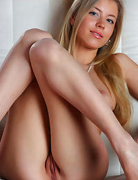 Beautiful Euro hottie Barbara spreads her legs to uncover her muff