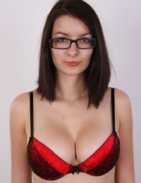 Pretty glasses clad brunette Veronika gets naked to show her tits close up