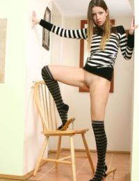 Wild teen girl Mika A shows off her pussy in over the knee socks
