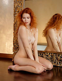 Flaming hot redhead Adel C practices her sultry poses naked in the mirror