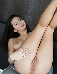 Gorgeous young angel Oretha unveils her small tits and her bald twat