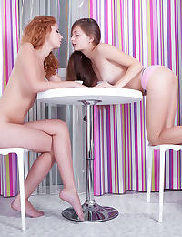 Young girls Tofana A & Ennu A do lesbian love things over a cup of tea