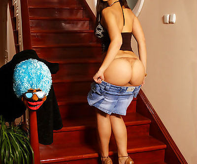 Sexy female Eve Angel spreads her bare ass cheeks on the stairs
