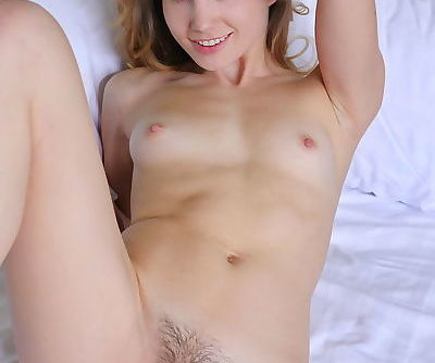 Teen solo girl Lola Krit lets her tiny tits free and she takes off her clothes
