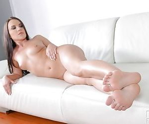 Leggy brunette beauty Wendy Moon displaying nice feet and pierced vagina