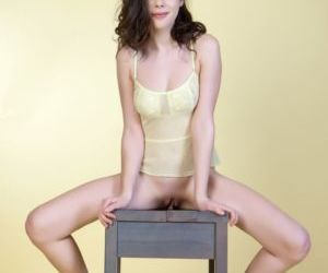 Beautiful young Halley spreading naked in the chair showing her meaty clit