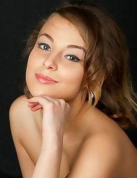 Beautiful young Nikia flashes a hot no panties upskirt before baring tiny tits