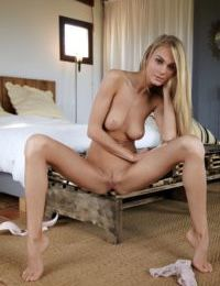 Tall slender blonde Nancy A poses naked with her long legs spread wide open