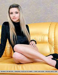 Blonde girl Salma C shedding satin onesie and high heels to model nude