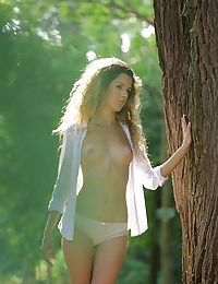 Pretty European solo model Monique Woods masturbating teen pussy in forest