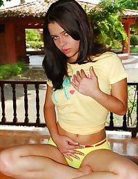 Latina teen with nice breasts rides a vibrator on veranda table