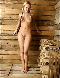 Young blonde cutie in pigtails poses naked to show puffy nipples & tiny ass