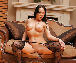 Steamy MILF in sexy stockings undressing and teasing her hungry pussy