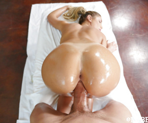 Busty female August Ames oiled up before fucking large penis