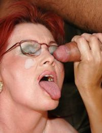 Redhead mature lady is into groupsex with younger babe and horny guy
