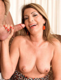 Topless older woman Vivi Ana sucks off a cock while fingering herself