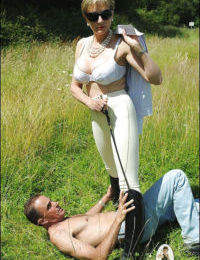 Lusty femdom in sunglasses spends some good time with her male pet outdoor