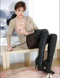 Lusty mature femdom tortures her blindfolded and overwrapped manslave
