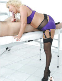 Curvy mature blonde in lingerie and stockings gives a slurpy blowjob