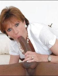 Horny mature babe in stockings sucks and fucks a big black boner