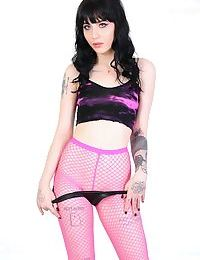Gothic tattooed bitch Charlotte Sartre poses in sexy pink fishnets