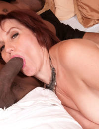 Older woman Debi greets a black stud for hard fuck wearing sexy lingerie