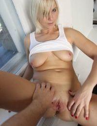 Older blonde broad bares big natural tits before fingering shaved vagina