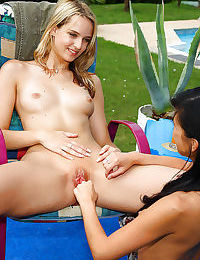 Pretty blonde lesbian gets her pink pussy fisted by her brunette friend