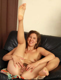 Older lady Valentine curls and uncurls her toes before showing her hairy muff