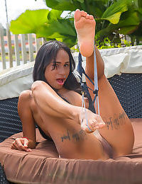 Young nubile Sofia Suarez removes yoga pants outdoors to sun her bald pussy