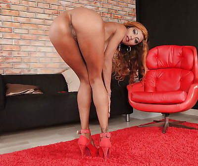 Latina sol model Manuella Pimenta showing off great legs and tight ass