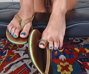 Asian solo girl Annie Cruz showing off painted toes and barefeet