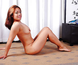 Tiny Asian lady Laci Hurst licks her own tits while stripping naked