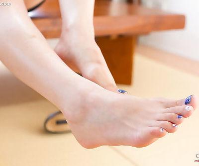 Japanese woman exposes her feet with blue nail polish while masturbating
