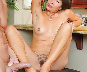 Older Asian lady Sakura Lei jacking dick with her bare feet
