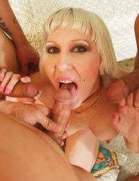 Aged blonde Dalny Marga giving blowjobs for cumshots in blowbang action