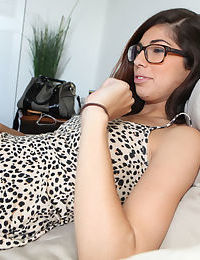Babe brunette Ava Taylor is lying on the bed and showing her pussy