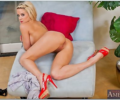 Busty blonde babe Tia McKenzie stripping and spreading her sexy legs