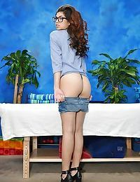 Luscious teen in glasses and jeans shorts undressing before massage