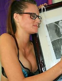 Petite teenage chick in glasses gives a handjob and receives a large facial