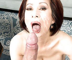 Busty Asian granny Kim Anh giving big cock BJ before facial cumshot