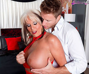 Big boobed granny Sally DAngelo seduces a younger man for a wild sex romp