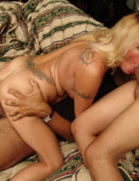 Two hard dicks are banging slutty mommy Lexxy Foxx simultaneously