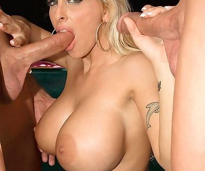 Busty milf Holly Haiston gets to suck on two cocks before shes fucked