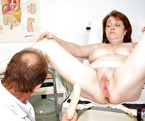 Grannys hairy pussy is dripping wet- fingered & spread at the Gyno