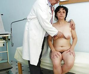 Flabby granny at gyno getting her hairy cunt stretched to the limits