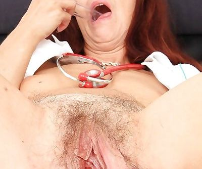 Mature european Lada masturbating her old pussy in nurse uniform