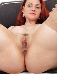 Redhead Beatrix shows her big tits and spreading that wet pussy