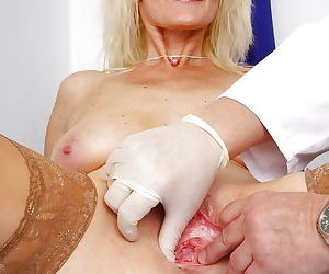 Blonde granny Mia and her saggy tits pose in white underwear and pantyhose