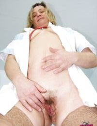Raunchy mature nurse taking off her panties and exposing her hairy cunt